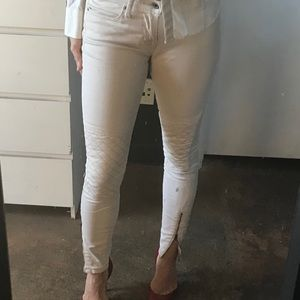 Light beige skinny jeans with zippered ankles